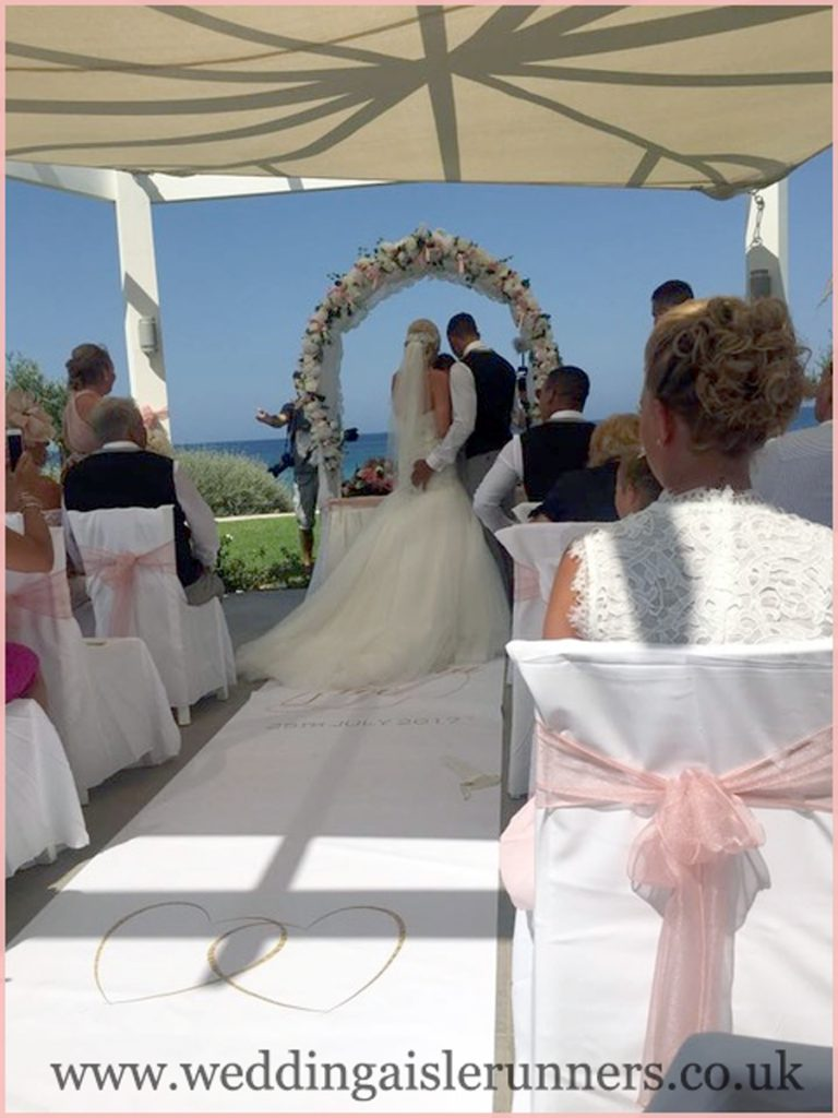 Gemma and Joe and their wedding aisle runner in Cyprus
