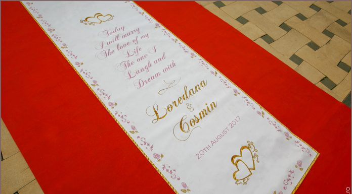 Pink and gold roses border wedding aisle runner